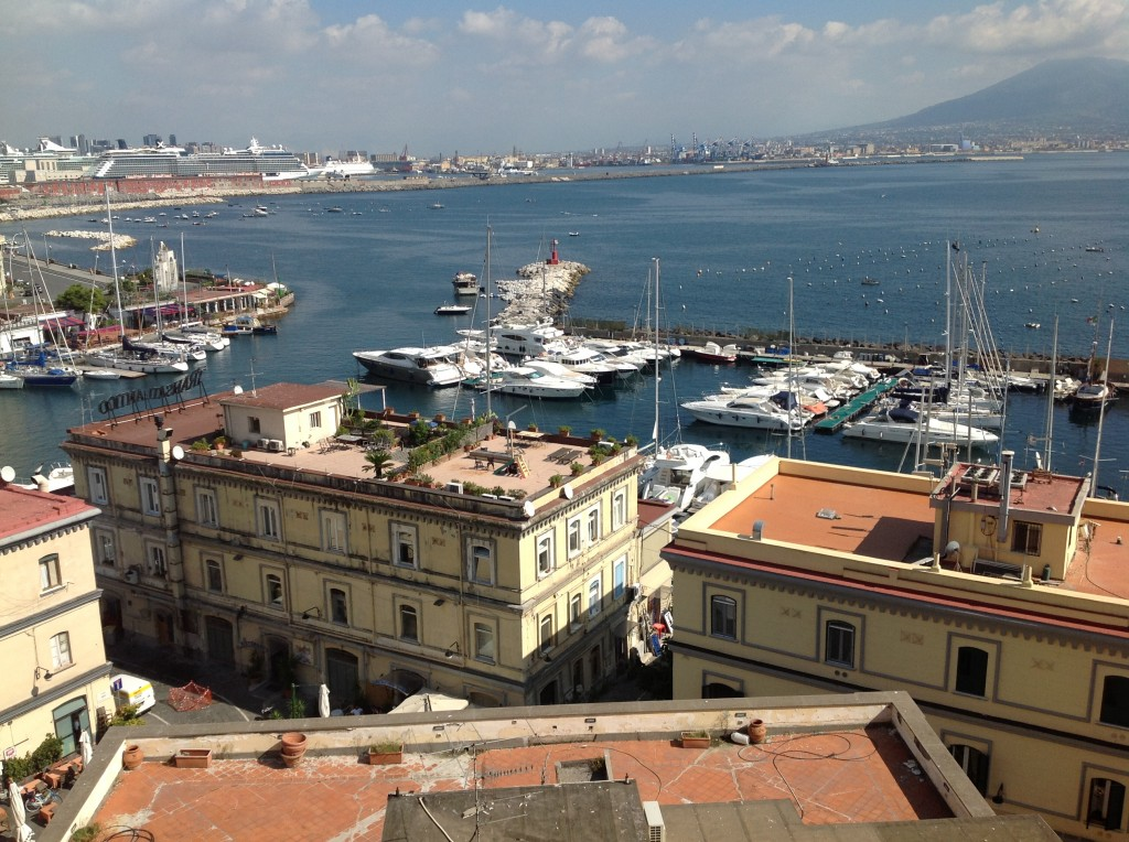Naples, Italy Bay with tall building in foreground.