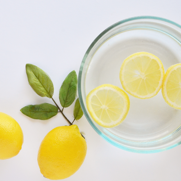 Lemons with a glass of lemon water