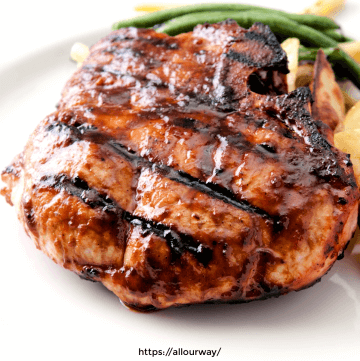 Grilled Pork Loin Chop in White plate with green bean on the side