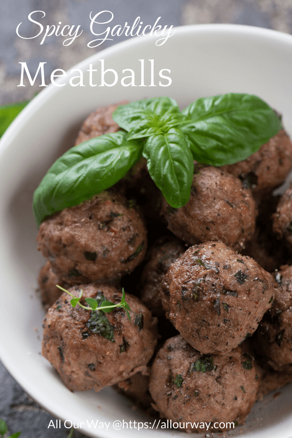 Spicy garlicky meatballs are easy to make ahead and freeze. Bake them in the oven, cool, then put them on a cookie sheet until frozen. So simple to grab a handful and make a spectacular dish or sandwiches. #meatballs, #Italian meatballs, #bakedmeatballs, #spicymeatballs, #howtofreezemeatballs