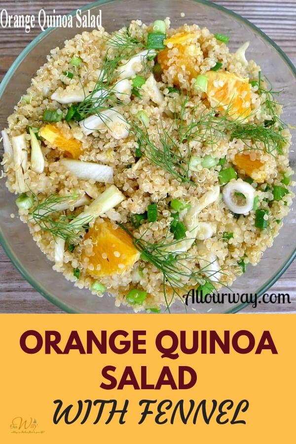 Clear glass bowl full of an orange quinoa salad with chunks of orange, fennel, and green sprigs of fennel on top of quinoa.