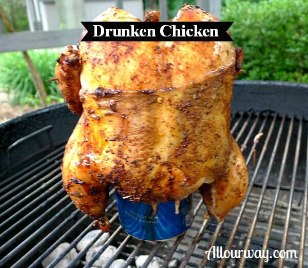 Drunken Chicken on a beer can on top of charcoal grill.