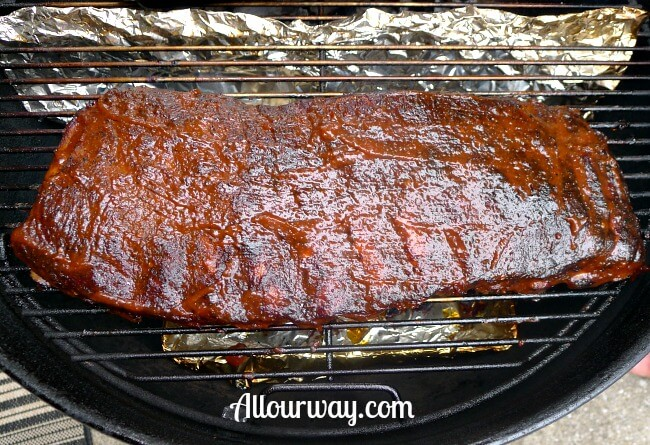 Smoking Pork Ribs on The Grill - first coat of barbecue sauce at allourway.com