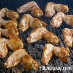 Chicken wings on the grill with the outer side down at allourway.com