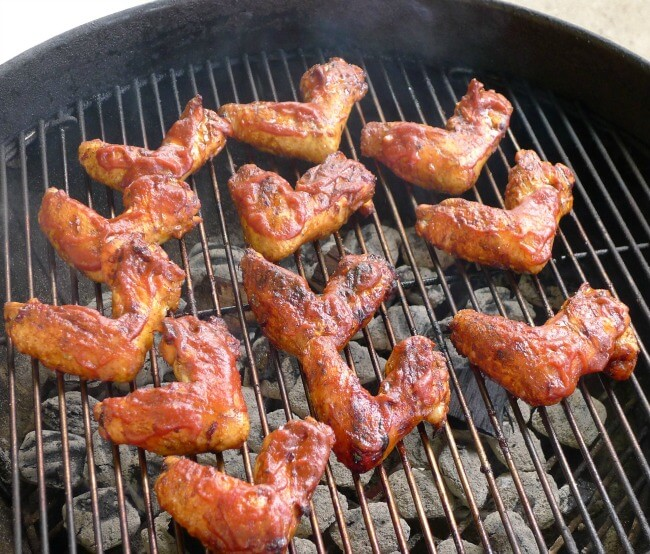 Chicken wings on the grill with All Our Way Bourbon Barbecue Sauce at allourway.com