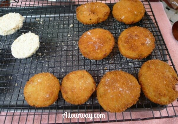 Crunchy fried green tomatoes , salted and ready to eat at allourway.com