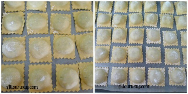 Italian Ravioli are placed on a parchment lined baking sheet ready to freeze at allourway.com