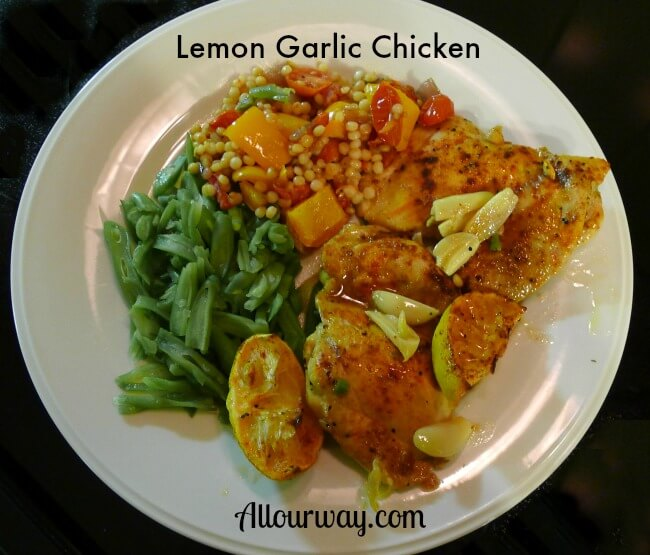 Lemon Garlic Chicken Plated with peppery couscous and green beans at Allourway.com