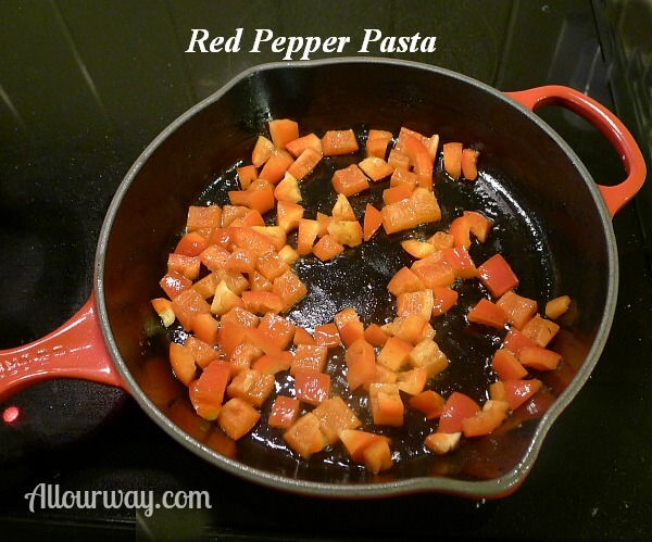red bell pepper diced and sauteing in skillet for the red pepper pasta with bacon at allourway.com