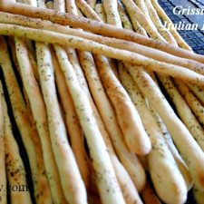 Grissini - crunchy Italian breadsticks cooling on rack @allourway.com