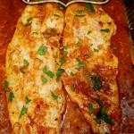 Spicy Baked Sea Trout in Lemon Butter Sauce in oblong glass baking dish