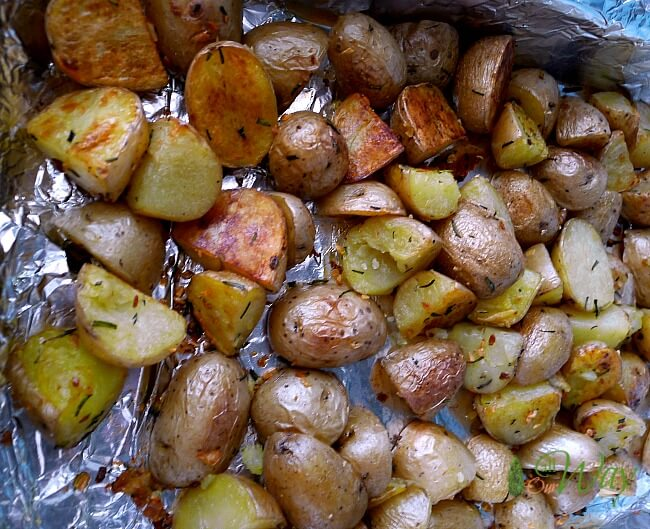 Roasted Rosemary Potatoes with Garlic on lined baking sheet @allourway.com