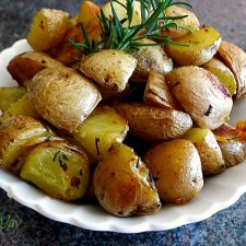 Roasted Rosemary Potatoes with Garlic in a Bowl Ready to Serve @allourway.com