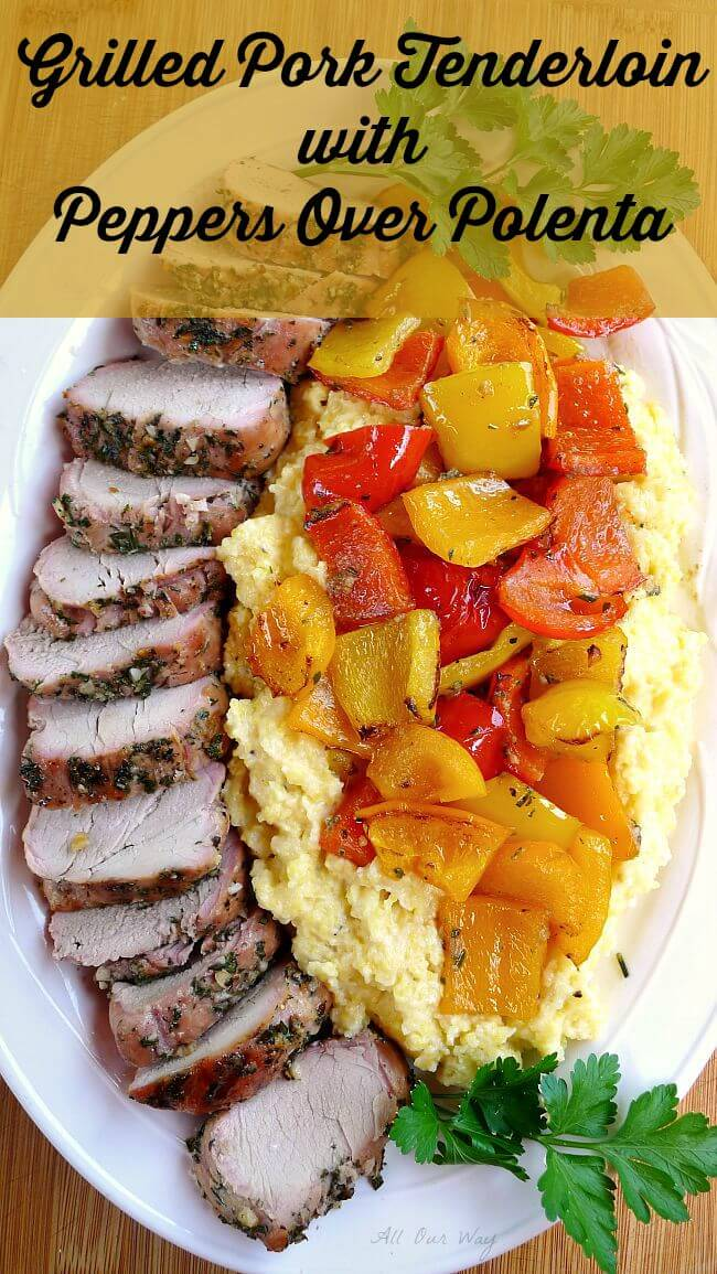 Grilled whole pork tenderloin slice with colored peppers over polenta on a white platter@allourway.com