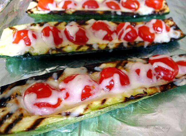 Grilled Stuffed Zucchini with Grape Tomatoes and oozing with cheese @ allourway.com