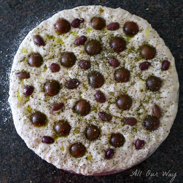 Focaccia Pugliese with Cherry Tomatoes and Kalamata Olives in metal pan. @allourway.com