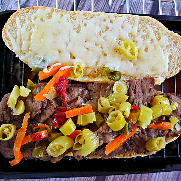 Italian Beef on a Italian hoagie bun with giardiniera on top.