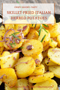 Skillet full of fried sliced potatoes with herbs and onions.