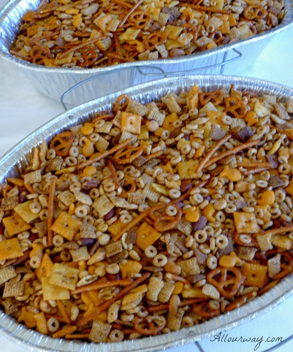 Two large roasting pan filled with Party Mix will go along with the Piña Colada Biscotti to give as gifts @allourway.com