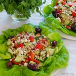 Mediterranean Grain Salad with Gorgonzola served on a bed of Boston green lettuce features grape tomatoes, kalamata olives, and the grain is farro.