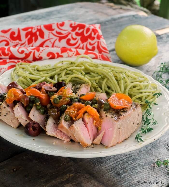 Southern Italian Grilled Tuna Steaks topped with a fresh sauce made up of grape tomatoes, capers, olives, wine and lemon @allourway.com