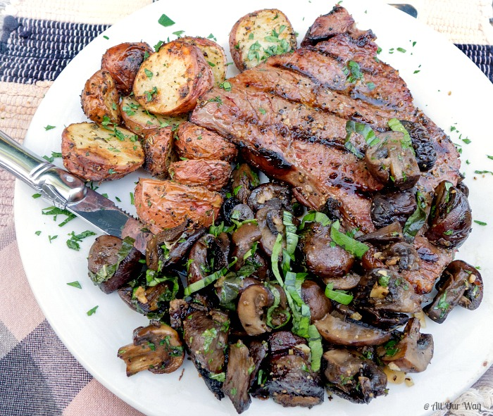 Lemon Herb roasted Mushrooms Recipe plated with roasted potatoes and grilled steak @allourway.com
