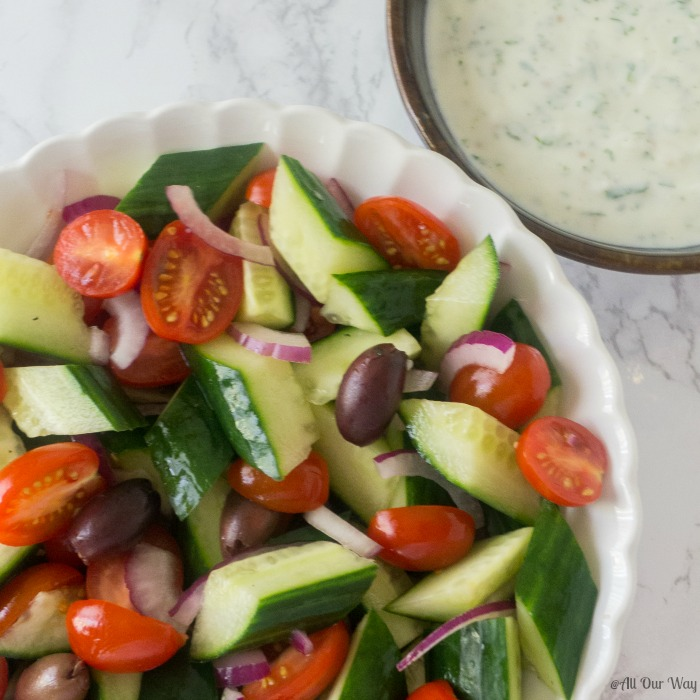 Mediterranean Tomato Cucumber Salad with Spicy Yogurt Dressing @allourway.com