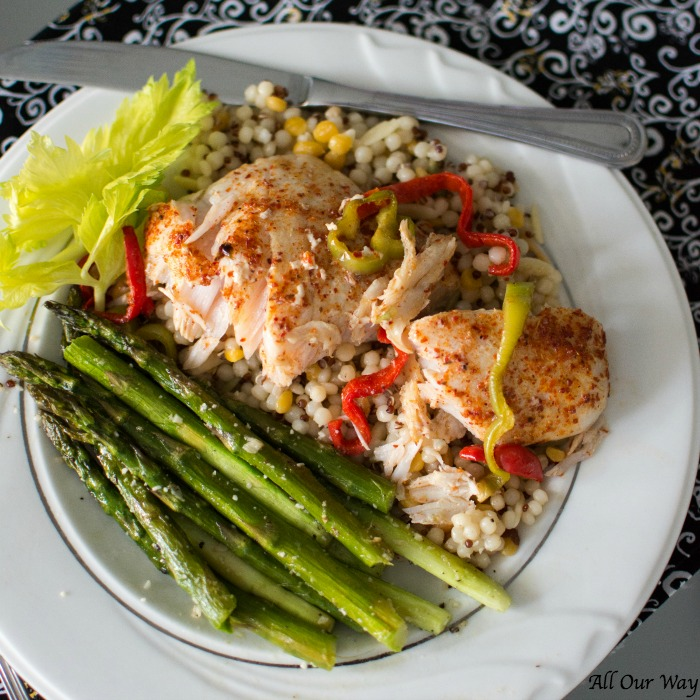 Roasted Lemon Garlic Asparagus with Parmesan served with Baked Corvina with Lime Garlic Butter and Peppers. A delicious meal fit for company or easily served during the week.