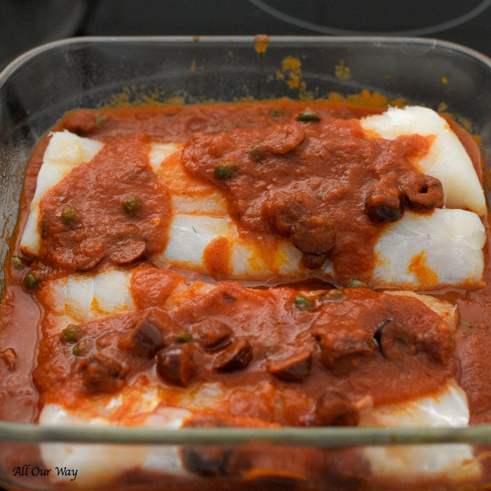 Baked Cod Puttanesca is a quick and easy dish that bakes cod fillets with a spicy tomato sauce that's boosted with kalamata olives, capers, and red pepper flakes.