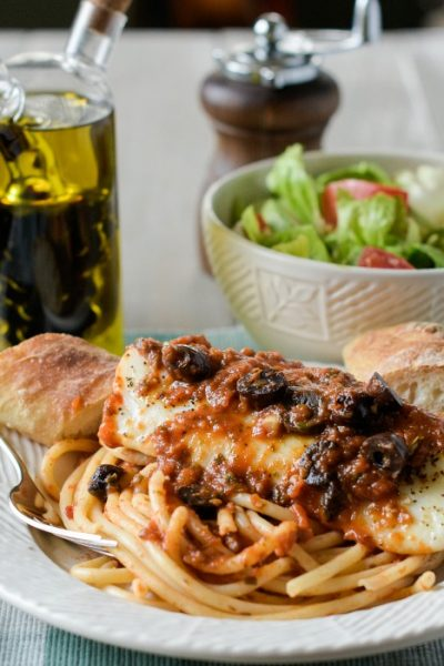 Baked Cod Puttanesca is a quick and easy recipe that bakes cod fillets with a spicy tomato sauce thats boosted with kalamata olives, capers and red pepper flakes.