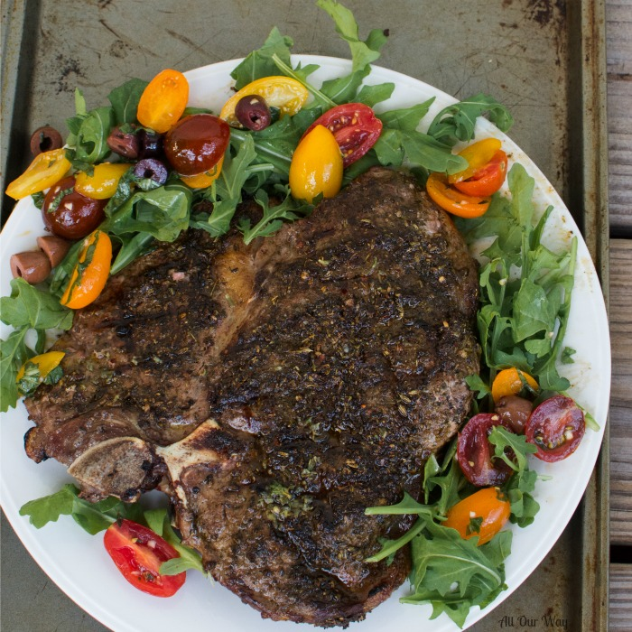 Grilled Porterhouse Steak Sicilian Style with Marinated Cherry Tomatoes over Arugula. Tuscan steak with a spicy Italian marinade.