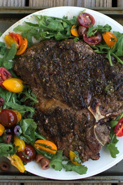 Grilled Porterhouse Steak Sicilian Style with Marinated Cherry Tomatoes & Kalamata Olives