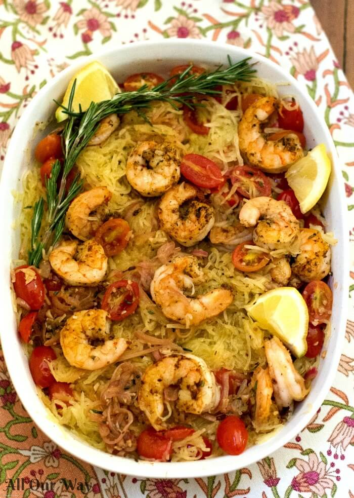 Sautéed shrimp with rosemary and tomato combined with spaghetti squash. A tasty easy one-pan meal.