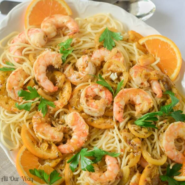 One Pan Orange Lemon Shrimp A Citrusy Touch of Capri is a light yet tasty seafood dish over pasta.