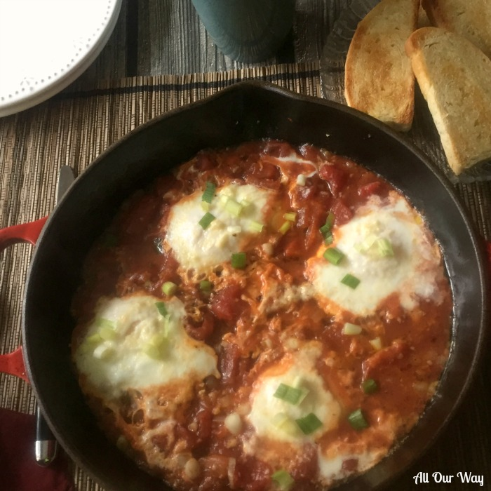 Spicy Eggs in Purgatory an Italian dish that poaches eggs in a spicy tomato sauce.