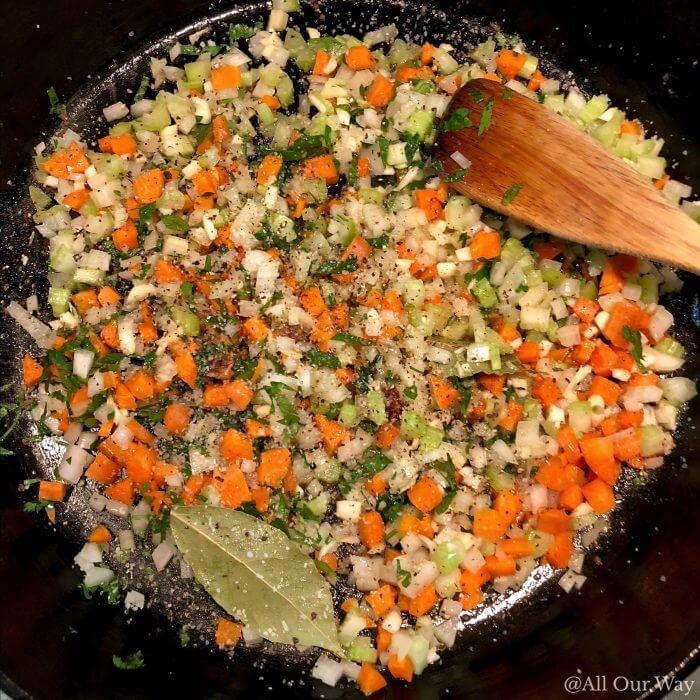 Vegetables sautéing in cast iron pan.