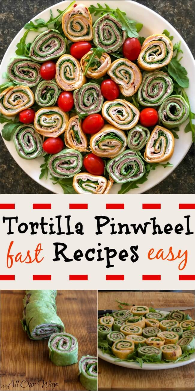 Two flavors of pinwheel appetizers on white plate with a cutting board in the background. Green spinach tortilla wraps and tomato tortilla spirals on a bed of arugula with grape tomatoes.