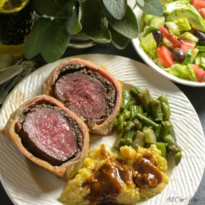Italian Venison Wellington with Marsala Gravy on Plate #venison_tenderloin, #venison_wellington, #meat_in_puff_pastry, #deer_tenderloin, #holiday_main_dish, #allourway