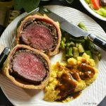 Italian Venison Wellington on plate with polenta and Marsala sauce.#venison_tenderloin, #marsala_sauce, #deer_meat, #puff_pastry, #venison_fillet, #roast_venison, #allourway