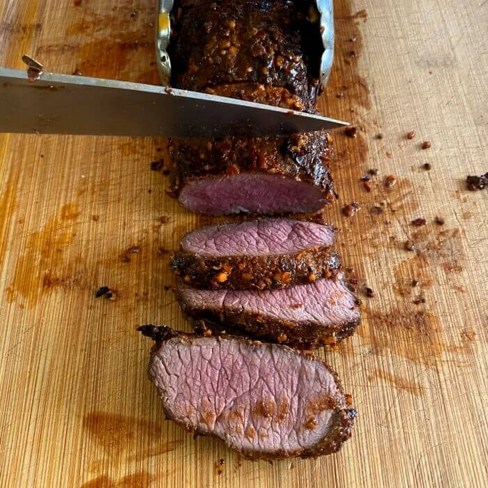 Venison loin slices after being grilled.
