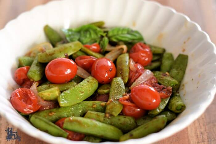 Roasted Snap Peas in a bowl with grape tomatoes