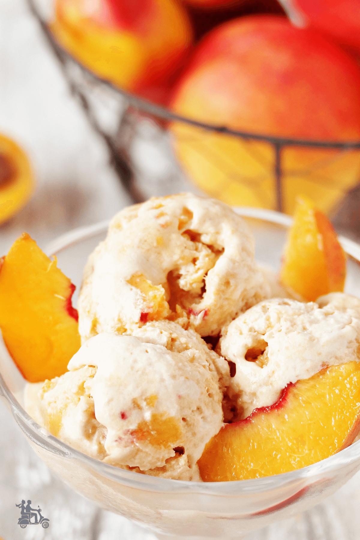 Peach no-churn ice cream in bowl with peaches.