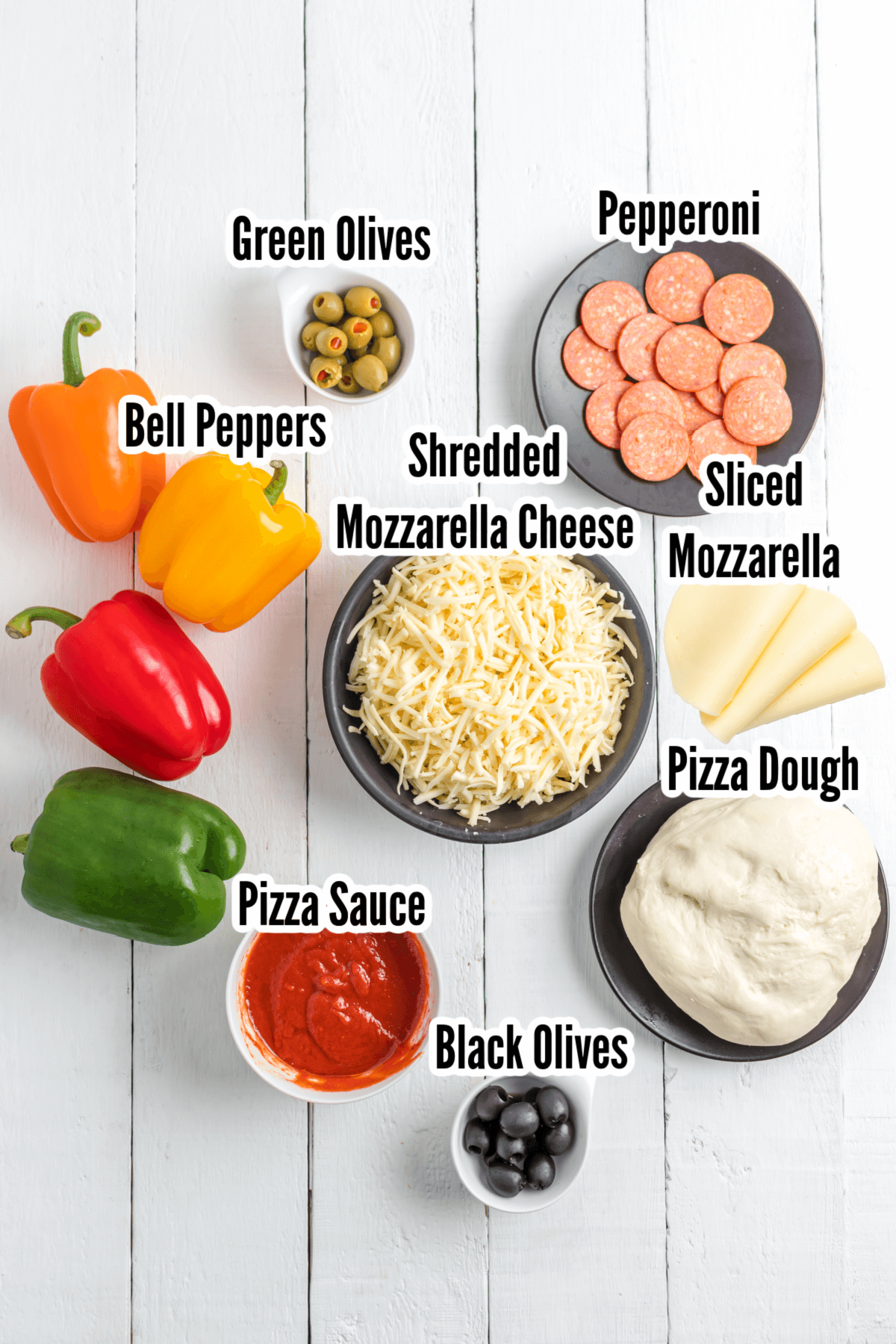 Simple ingredients make up mini- Halloween party pizzas.